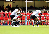 Pictured: Fiji players doing the haka before kick off. Saturday 15 November 2014<br />