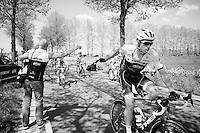 Boy Van Poppel (NLD/Trek-Segafredo) catching his musette in the feedzone from soigneur Joaquin Gonzalez<br /> <br /> stage 2: Arnhem-Nijmegen (NLD) 190km<br /> 99th Giro d'Italia 2016