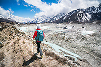 Hiking between Gokyo and Thangnak is alongside a rock glacier filled with lakes, Nepal Himalaya