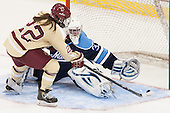 Haley Skarupa (BC - 22) scores on Meghann Treacy (Maine - 31). - The Boston College Eagles defeated the visiting University of Maine Black Bears 5 to 1 on Sunday, October 6, 2013, in their Hockey East season opener at Kelley Rink in Conte Forum in Chestnut Hill, Massachusetts.