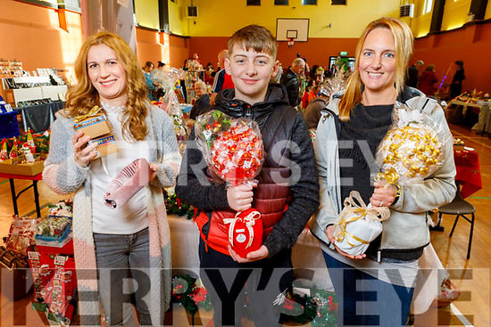 Kasia Tomvzha, Eathon Farley and Helen McCarthy displaying their crafts at the Arty Bits Craft Fare in KDYS on Saturday.