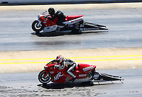 Sep 14, 2013; Charlotte, NC, USA; NHRA pro stock motorcycle rider Anne Hansen (near) races alongside Wesley Wells during qualifying for the Carolina Nationals at zMax Dragway. Mandatory Credit: Mark J. Rebilas-