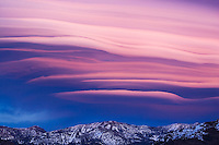 Lenticular clouds at sunset above the Carson Range in Nevada, USA