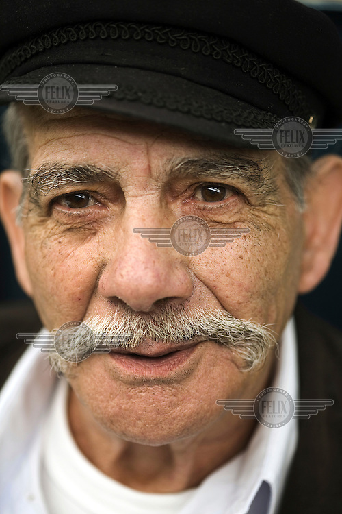 Portrait of an elderly man on a stall at the Mahane Yahuda market in Jerusalem.