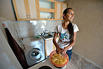 Rachel Ismili, a 15-year old Roma youth in Suto Orizari, the Macedonian municipality that is Europe's largest Roma settlement, prepares to cook a meal in her family's home.
