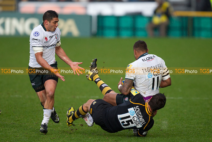 Hugo Southwell (c) of London Wasps RFC halts Sailosi Tagicakibau of London Irish RFC - London Wasps RFC vs London Irish RFC - Aviva Premiership Rugby at Adams Park, Wycombe Wanderers FC - 03/03/12 - MANDATORY CREDIT: Ray Lawrence/TGSPHOTO - Self billing applies where appropriate - 0845 094 6026 - contact@tgsphoto.co.uk - NO UNPAID USE.