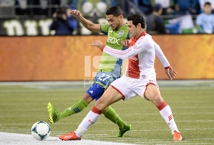November, 2013: CenturyLink Field, Seattle, Washington:  Seattle Sounders FC midfielder/forward Lamar Neagle (27) stretches for the ball against Portland Timbers midfielder Diego Valeri (8) as the Portland Timbers take on the Seattle Sounders FC in the Major League Soccer Playoffs semifinals Round. Portland won the first match 2-1.