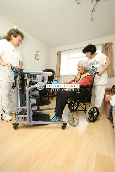 Live-in Health Care Managers give 24 hour support to elderly woman in wheelchair North London
