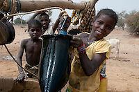 Children collecting water from the well