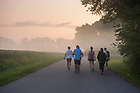 August 15, 2017;  Pilgrims start out at dawn to make the 39 mile trek, 18 walking and 21 biking on day 2 of the ND Trail from Oaktown to Terre Haute, Indiana. As part of the University's 175th anniversary celebration, the Notre Dame Trail will commemorate Father Sorin and the Holy Cross Brothers' journey. A small group of pilgrims will make the entire 300+ mile journey from Vincennes to Notre Dame over  two weeks. (Photo by Barbara Johnston/University of Notre Dame)
