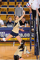 11 September 2011:  FIU outside hitter Marija Prsa (10) taps the ball over the net in the third set as the FIU Golden Panthers defeated the Florida A&M University Rattlers, 3-0 (25-10, 25-23, 26-24), at U.S Century Bank Arena in Miami, Florida.