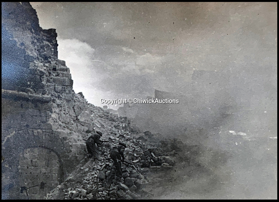 BNPS.co.uk (01202 558833)<br /> Pic:  ChiswickAuctions/BNPS<br /> <br /> Allies in the heat and dust during the attack on Monte Cassino.<br /> <br /> Remarkable previously unseen photos documenting the momentous closing stages of World War Two and its historic aftermath have come to light.<br /> <br /> They were taken by Sergeant Charles Hewitt, of the Army Film and Photographic Unit, who later went on to work for the Picture Post and the BBC.<br /> <br /> He was present at many of the important offensives of 1944 and '45 including the Battle of Monte Cassino during the Italian Campaign and the Allies advance into Germany following the D-Day invasion.