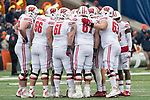 Wisconsin Badgers offense huddles during an NCAA College Big Ten Conference football game against the Illinois Fighting Illini Saturday, October 28, 2017, in Champaign, Illinois. The Badgers won 24-10. (Photo by David Stluka)
