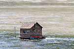 IMAGES OF THE YUKON,CANADA , BOAT HOUSE ON THE YUKON RIVER