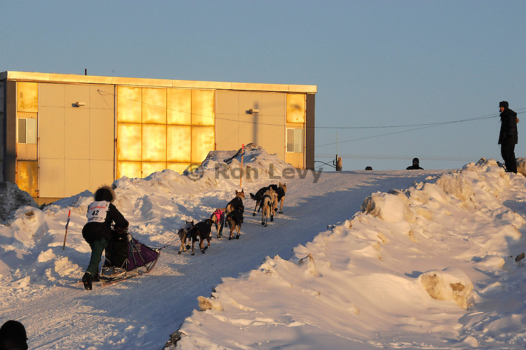 Iditarod musher Sven Hartmann climbs up from Bering Sea to Nome, Alaska.