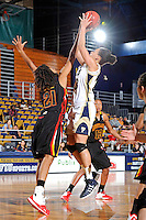 25 November 2011:  FIU guard-forward Finda Mansare (23) shoots a jump shot over Maryland guard-forward Tianna Hawkins (21) in the second half as the University of Maryland Terrapins defeated the FIU Golden Panthers, 84-52, at the U.S. Century Bank Arena in Miami, Florida.