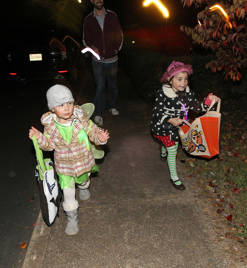 Ava Grey Shurtleff goes trick or treating with Sonny, Ryan and his mom for Halloween on Monte Vista Avenue in Charlottesville, VA. Photo/Andrew Shurtleff