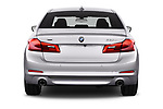 Straight rear view of 2017 BMW 5-Series Sport 4 Door Sedan Rear View  stock images