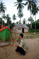 Jan. 02, 2008 - Rabbit Island, Cambodia. A fisherman paints his boat on Rabbit island. © Nicolas Axelrod / Ruom