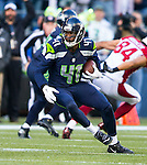 Seattle Seahawks cornerback Byron Maxwell returns an interception against the Arizona Cardinals at CenturyLink Field in Seattle, Washington on November 23, 2014. The Seahawks beat the Cardinals 19-3.   ©2014. Jim Bryant Photo. All Rights Reserved.
