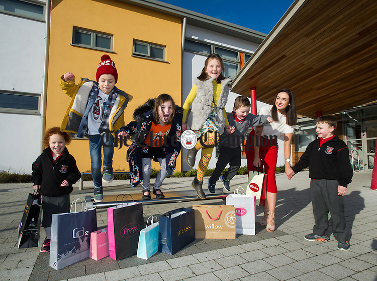 Leaping into Fashion...Pupils Caoimhe Casey, Christopher Flynn, Sally Fennell, Aisling O Connor, Joe Fennell,  and James Keller with model Brenda Monahan at the launch of the Ennis NS fundraising Fashion Show which will take place on 11th November at Treacys West County Hotel at 7pm. Photograph by John Kelly.