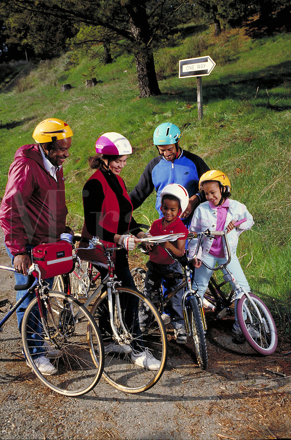 AFRICAN-AMERICAN EXTENDED FAMILY OUT CYCLING TOGETHER. EXTENDED FAMILY. OAKLAND CALIFORNIA USA HOME.