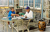 United States President George H.W. Bush works with his personal assistant Linda Casey at his home at Walkers Point in Kennebunkport, Maine August 22, 1990.<br /> Mandatory Credit: Carol T. Powers / White House via CNP