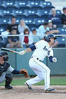Austin Cousino #19 of the Everett AquaSox bats against the Tri-City Dust Devils at Everett Memorial Stadium on July 29, 2014 in Everett, Washington. Everett defeated Tri-City, 7-5. (Larry Goren/Four Seam Images)