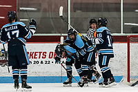BOSTON, MA - JANUARY 04: Goal celebration. Michelle Weis #19 of University of Maine celebrates her goal with teammates during a game between University of Maine and Boston University at Walter Brown Arena on January 04, 2020 in Boston, Massachusetts.