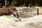 April 30, 2012. Charlotte, NC.. Rob Raker, one of Erik Weihenmayer's guides on the river, heads through the M Wave rapid.. Erik Weihenmayer, who has been completely blind since age 13, is training at the United States National White Water Center in an attempt to kayak through the Grand Canyon. Weihenmayer is an accomplished outdoorsman who has climbed the 7 Summits, and is the only blind person to climb Mount Everest.