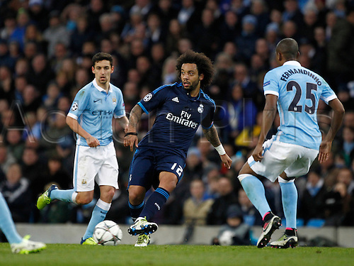 26.04.2016. The Etihad, Manchester, England. UEFA Champions League. Manchester City versus Real Madrid. Real Madrid defender Marcelo on the ball as Manchester City midfielder Fernandinho and Manchester City midfielder Jesús Navas close him down.