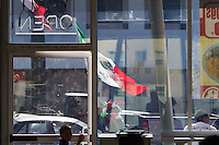 Los Angeles, CA -  Monday, June 23, 2014: A young Mexico celebrated Mexico's victory over Croatia outside a fast food restaurant in downtown Huntington Park.