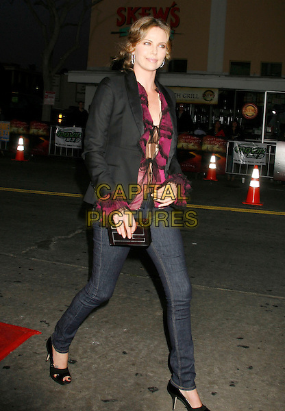 "CHARLIZE THERON.""The Reaping"" Los Angeles Premiere held at Mann's Village Theatre, Hollywood, California, USA..March 29th, 2007.full length skinny jeans denim black platform heels jacket purple sheer top.CAP/ADM/RE.©Russ Elliot/AdMedia/Capital Pictures"