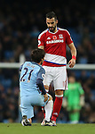 Alvaro Negredo of Middlesbrough helps up former colleague David Silva of Manchester City during the Premier League match at the Etihad Stadium, Manchester. Picture date: November 5th, 2016. Pic Simon Bellis/Sportimage