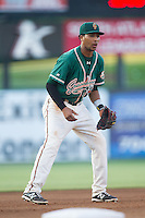 Greensboro Grasshoppers third baseman Rehiner Cordova (11) on defense against the Kannapolis Intimidators at CMC-Northeast Stadium on June 14, 2014 in Kannapolis, North Carolina.  The Grasshoppers defeated the Intimidators 4-2.  (Brian Westerholt/Four Seam Images)