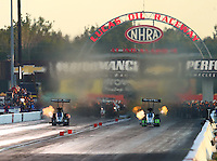 Sep 3, 2016; Clermont, IN, USA; NHRA top fuel driver Tripp Tatum (left) races alongside Clay Millican during qualifying for the US Nationals at Lucas Oil Raceway. Mandatory Credit: Mark J. Rebilas-USA TODAY Sports