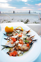 Dinner at a waterfront restaurant. Grilled sardines. Seafood restaurant at Macedonia Palace Hotel. Thessaloniki, Macedonia, Greece