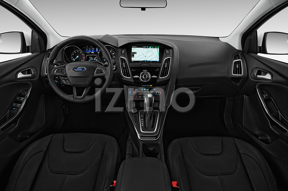 Stock photo of straight dashboard view of 2015 Ford Focus Titanium 4 Door Sedan Dashboard