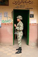 Egypt / Zagazig / 15.12.2012 / Military forces in a polling station in Zagazig. People descended on polling stations across Egypt to vote on the highly controversial draft constitution, which has been a source of intense political protest in recent weeks. <br /> <br /> © Giulia Marchi