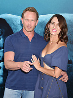 HOLLYWOOD, CA - AUGUST 06: Ian Ziering (L) and Erin Ludwig attend the premiere of Warner Bros. Pictures and Gravity Pictures' Premiere of 'The Meg' at the TLC Chinese Theatre on August 06, 2018 in Hollywood, California.<br /> CAP/ROT/TM<br /> &copy;TM/ROT/Capital Pictures