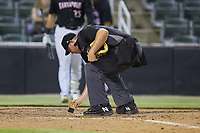 Bryan Van Vranken cleans off home plate during the game between the Hagerstown Suns and the Kannapolis Intimidators at Kannapolis Intimidators Stadium on August 26, 2019 in Kannapolis, North Carolina. The Suns defeated the Intimidators 4-1. (Brian Westerholt/Four Seam Images)