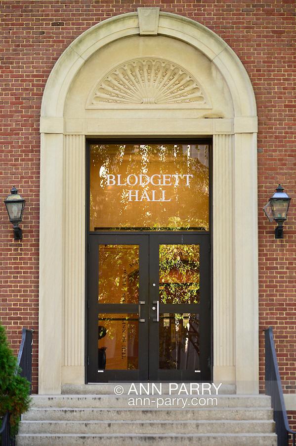 Garden City, New York, U.S. - August 29, 2014 - Adelphi University campus Blodgett Hall front entrance glass doorway and brick facade, in summer
