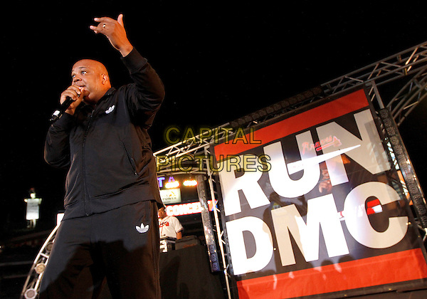 Joseph &quot;Run&quot; Simmons and Darryl &quot;DMC&quot; McDaniels, known together as Run DMC, reunited in Atlanta for a post-game concert after an Atlanta Braves game. Performing together for only the third time since Jam Master Jay's death in 2002, Run DMC performed their hits for the baseball fans who packed the infield and stands to hear the legendary hip-hop duo.  <br /> June 1st, 2013<br /> on stage in concert live gig performance performing music half length black tracksuit hand arm adidas <br /> CAP/ADM/DH<br /> &copy;Dan Harr/AdMedia/Capital Pictures