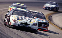 Rusty Wallace leads a pack of cars through turn 2 during the Pennzoil 400 at Homestead-Miami Speedway in November 2000. (Photo by Brian Cleary)