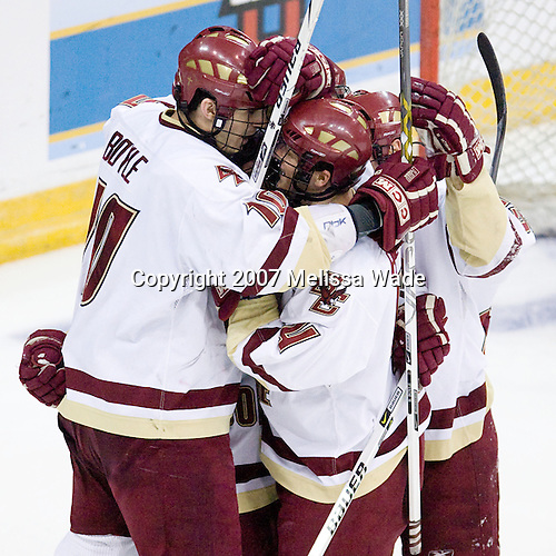 Brian Boyle (Boston College - Hingham, MA), Mike Brennan (Boston College - Smithtown, NY) (Gannon, Greene), and Matt Price (Boston College - Milton, ON)celebrate Brennan's goal (overturned - net off). The Boston College Eagles defeated the Miami University Redhawks 4-0 in the 2007 NCAA Northeast Regional Final on Sunday, March 25, 2007 at the Verizon Wireless Arena in Manchester, New Hampshire.