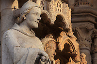 Statue of an apostle, restored 1821-47 under Auguste Cheussey, by the sculptor Theophile Caudron, on the embrasures of the central portal, known as the Beau-Dieu portal, dedicated to the Last Judgment, on the Western facade of the Basilique Cathedrale Notre-Dame d'Amiens or Cathedral Basilica of Our Lady of Amiens, built 1220-70 in Gothic style, Amiens, Picardy, France. The ommission of several attributes when replacing the statues means the apostles are now difficult to recognise. Amiens Cathedral was listed as a UNESCO World Heritage Site in 1981. Picture by Manuel Cohen