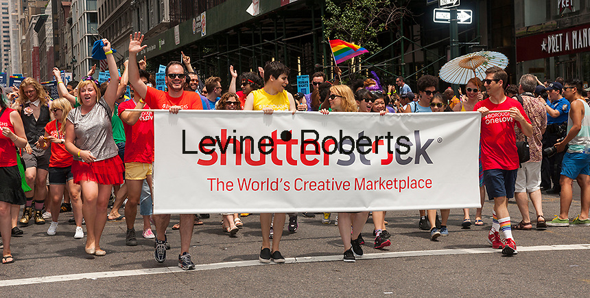Workers from Shutterstock march in the 44th annual Lesbian, Gay, Bisexual and Transgender Pride Parade on Fifth Avenue in New York on Sunday, June 30, 2013. Jon Oringer, the founder of the company, recently became the first Silicon Alley billionaire as shares of the stock agency reached a record high..  (© Richard B. Levine)