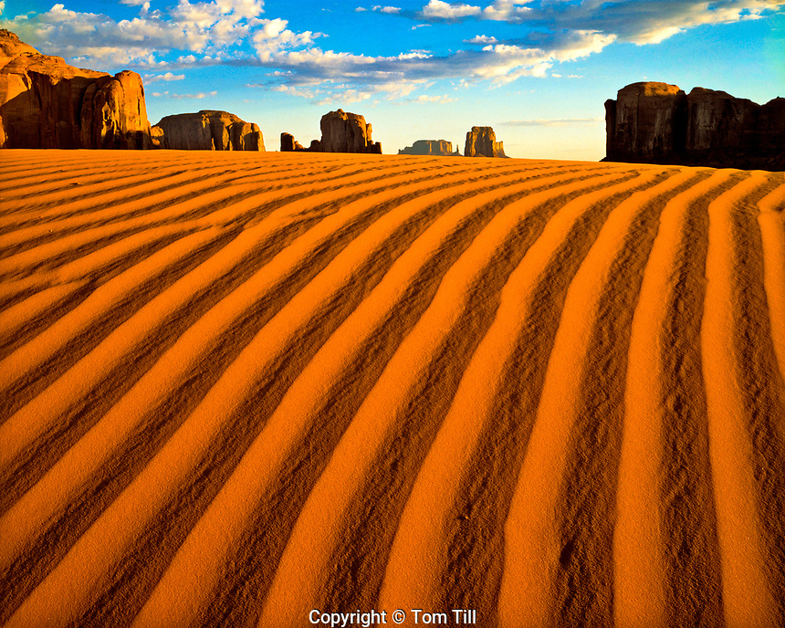 Sand dunes and monoliths, Monument Valley Tribal Park, Arizona, Navajo Reservation