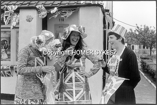 Silver Jubilee celebrations, London 1977.Uk Three women east end London neighbors chatting wearing union jack clothes.