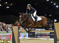 Elizabeth Madden (USA), riding Simon at the Gucci Gold Cup International Jumping competition at the 2015 Longines Masters Los Angeles at the L.A. Convention Centre.<br /> October 3, 2015  Los Angeles, CA<br /> Picture: Paul Smith / Featureflash